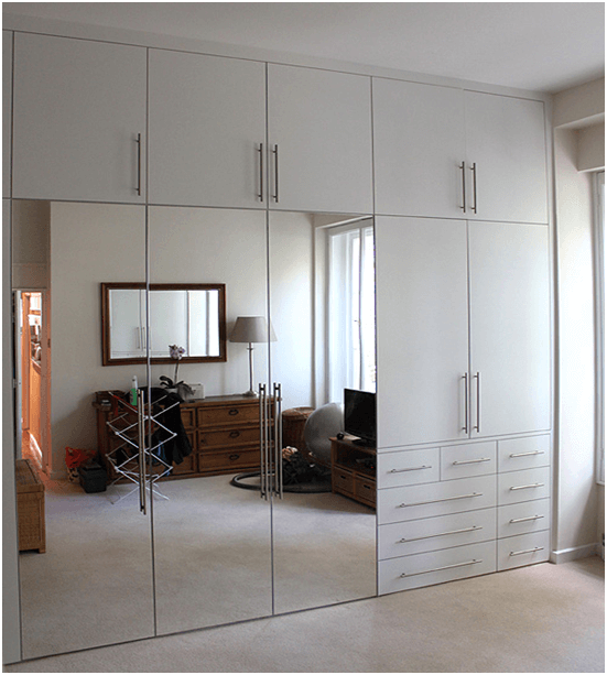 Tall wardrobes with PVC mirror laminate by homelane