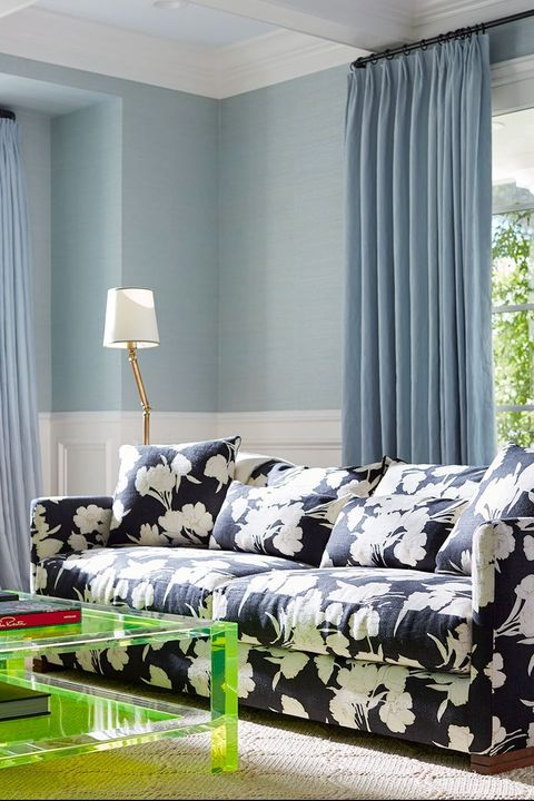 blue floral sofa in contemporary living room by livspace